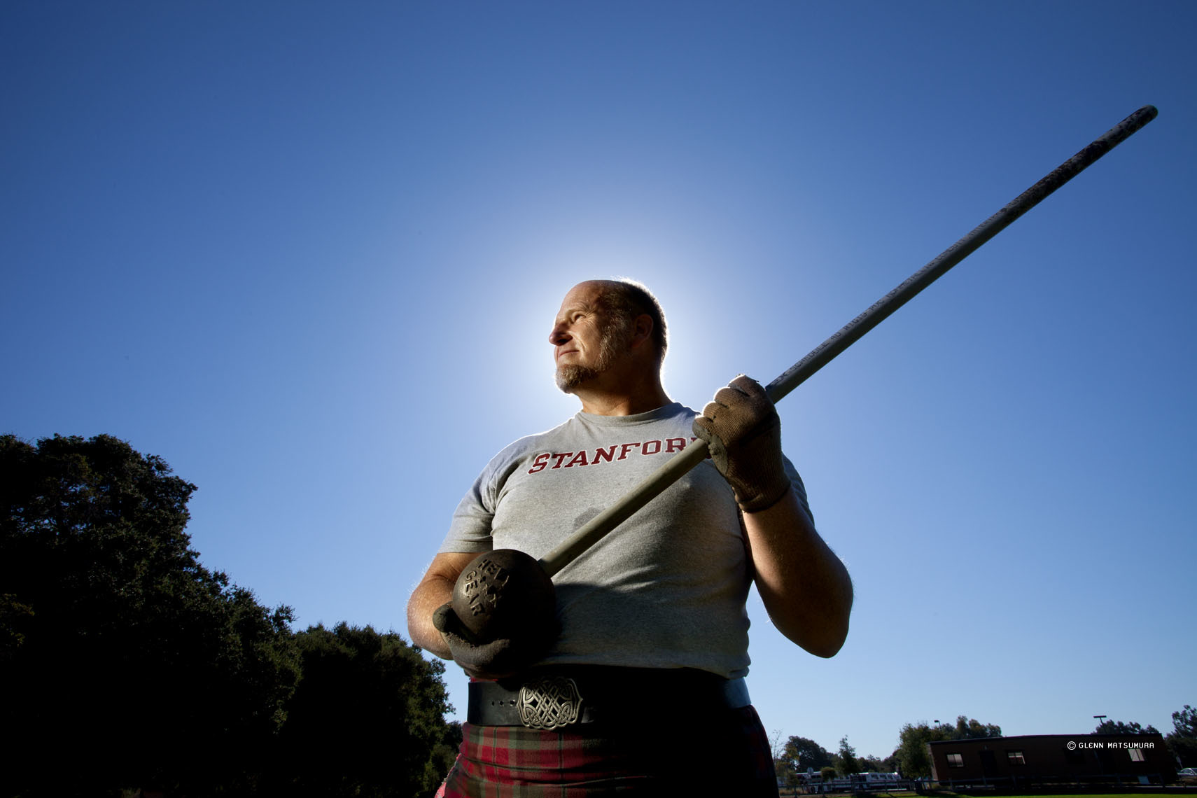 Alan Hebert holding a Scottish hammer, practices for the Scottis